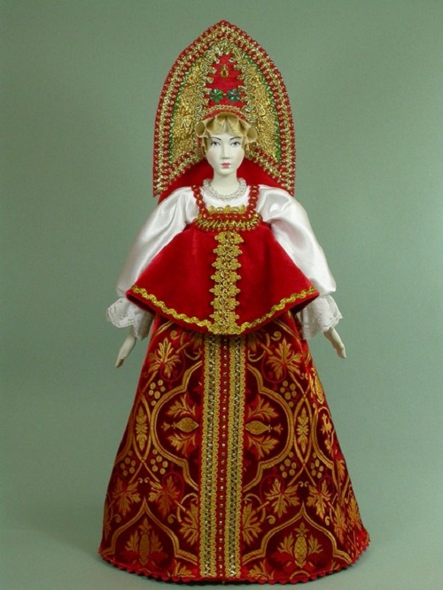 Red dress and kokoshnik, handmade doll in a folk dress. Biscuit porcelain, textiles, acrylic paint. Artist SY Krishtan
