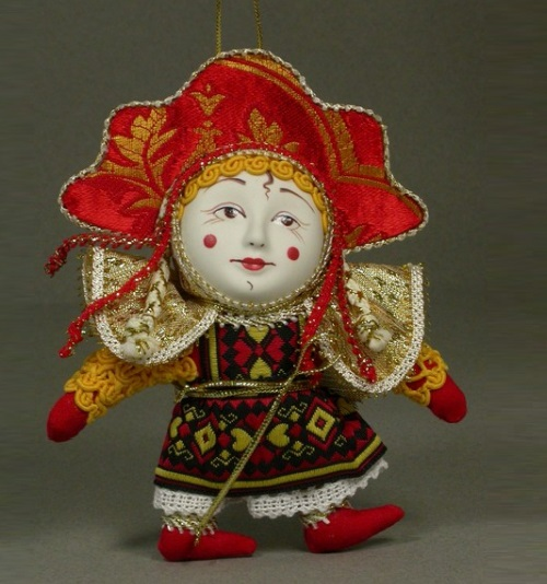 Doll wearing a mask, 'Sun'. Biscuit porcelain, textiles, acrylic paint. Artist AI Dubrovina