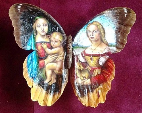 The images of Madonna with a child on wings of butterfly. Miniature painting by Mexican artist Cristiam Ramos