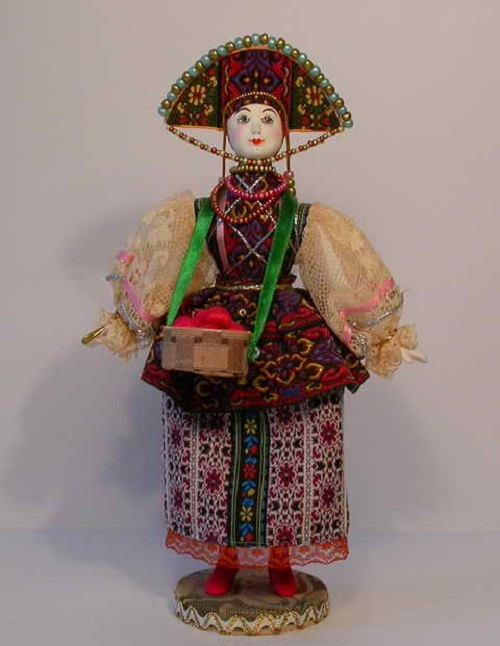 Russian doll from the series Old Petersburg. Biscuit porcelain, textiles, acrylic paint. Artist AI Dubrovina