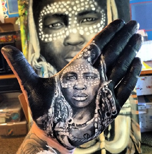 Painted on palm portrait of Ethiopian woman. Art by Russell Powell
