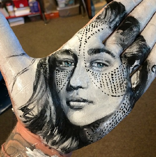 Portrait of Emilia Clarke. Painting on palm by Russell Powell