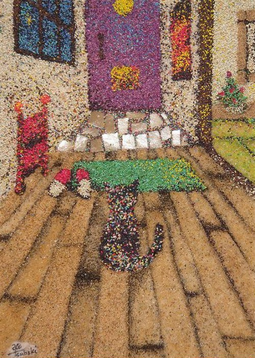 A pet cat in the house. Painted with granulated colored sand. Japanese artist Ako Tsubaki