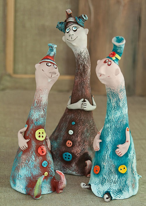 Freaks in buttons. Made of ceramic mass. Painted with acrylic paints