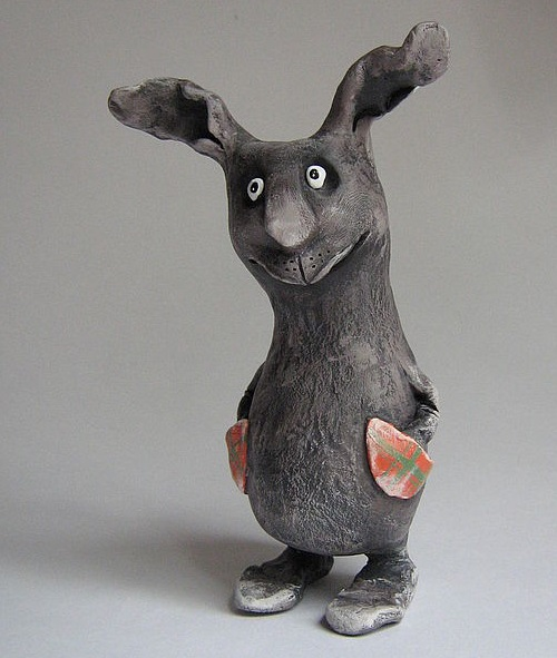 Hare with pockets. Made of ceramic mass. Painted with acrylic paints. Feet moving on waxed cord