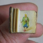 This Miniature book is full of tiny paintings