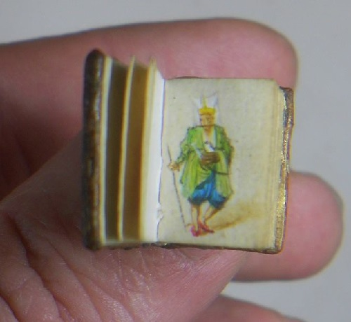 Miniature book with tiny paintings