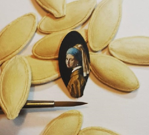 Iconic image of a girl with earring, micro painting on pumpkin seed