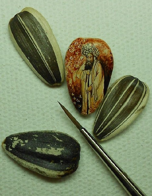 Miniature painting on a sunflower seed by Turkish artist Hasan Kale
