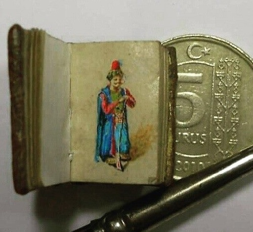 Miniature paintings in a tiny book