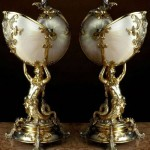 Two silvered and gilt-metal mounted nautilus cups, circa 1870