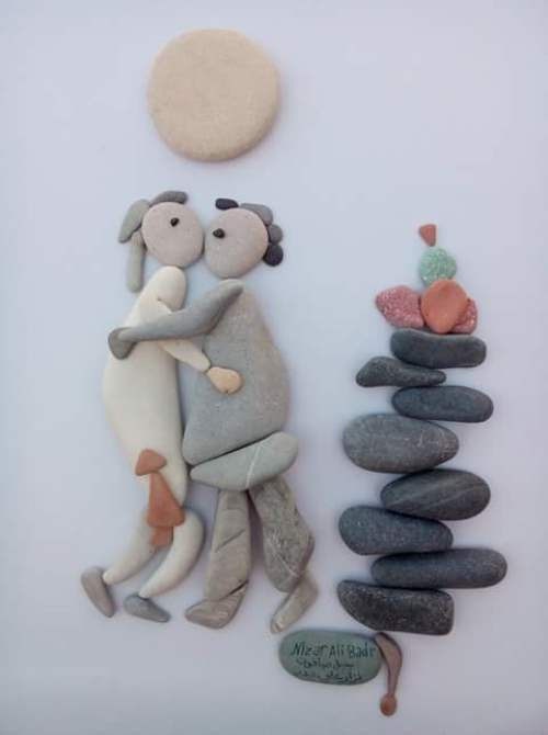 Love is... Pebble art by Latakia based sculptor Nizar Ali Badr, Syria