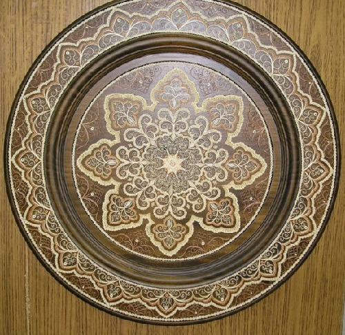 Wooden plate. Tsekunovka filigree wood art