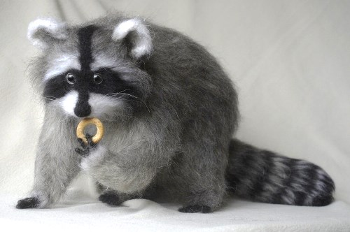 Racoon. Felted toys by Russian artist of applied art Natalia Fadeeva