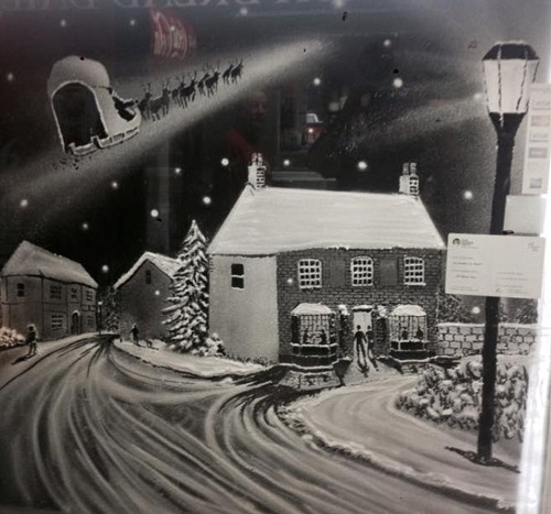 Christmas joy in painting on windows by English artist Tom Baker