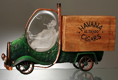 A truck carrying cigars. Wonderful work of engraved glass, metal, wood