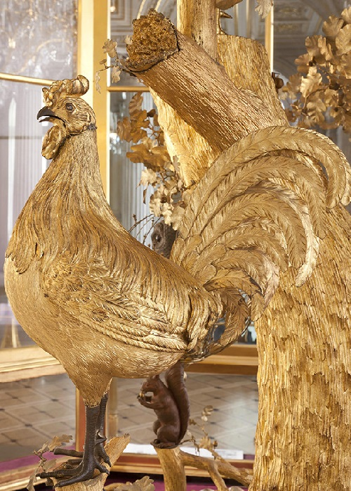 The peacock starts the mechanism of the golden cockerel