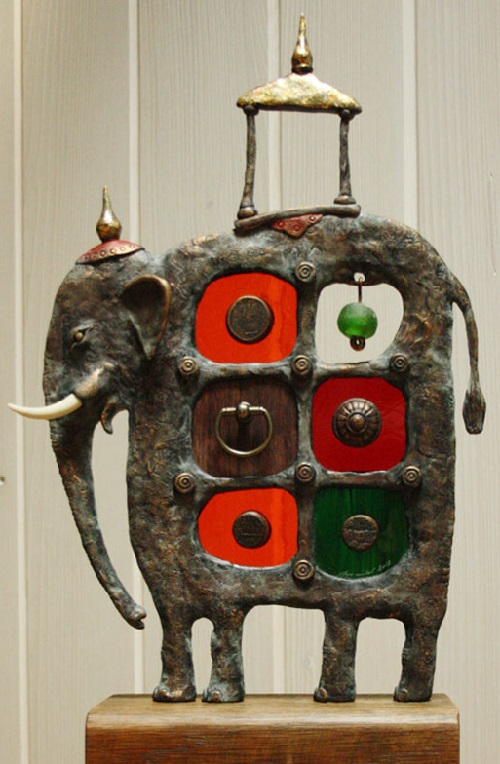 The temple elephant made of metal, epoxy, glass, wood. Engraved glass and metal sculpture by Czech glass artist Dalibor Nesnidal
