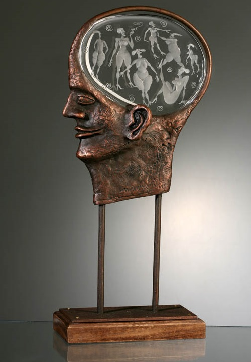 What is in man's head. Engraved glass and metal sculpture by Czech glass artist Dalibor Nesnidal