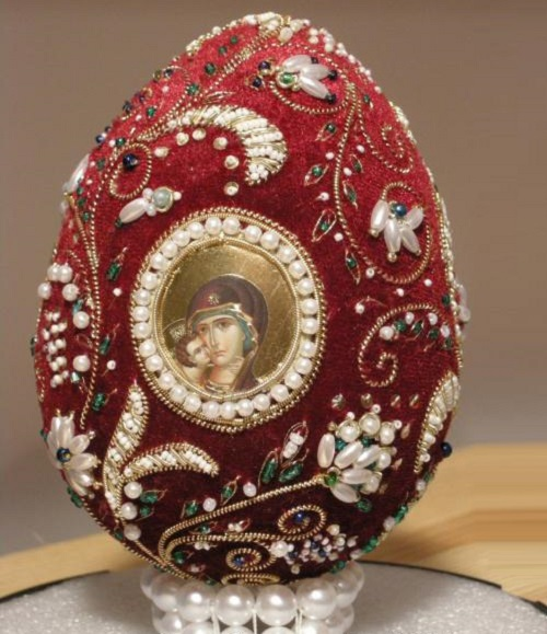 Beautiful Easter egg, richly embroidered by masters of gold embroidery workshop Ubrus