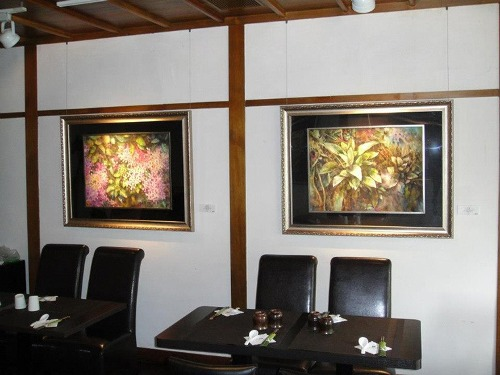 Watercolor pictures decorate the interior of cafes