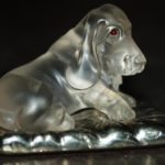 Basset. The material - quartz (rock crystal), garnet red eyes, stand of pyrite