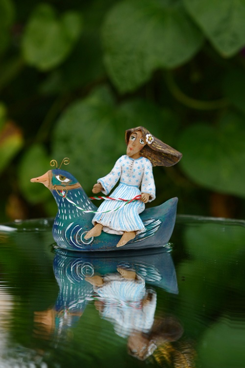 Clay Figurine Natasha. Happiness - it's bare feet touch the surface of the water, swimming and driving feel a warm wind