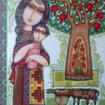 Mother with a child at the tree