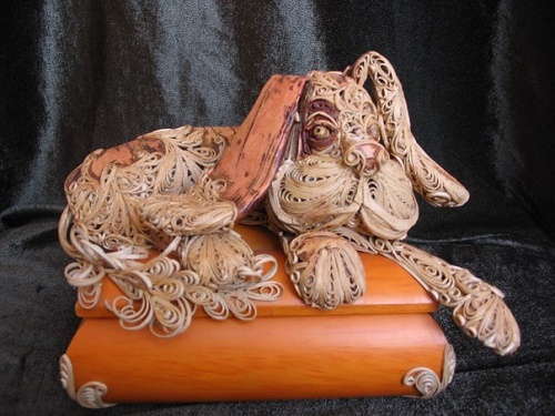 A dog. Vera Leontieva birchbark filigree art