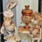 A rabbit and a home keeper at the tea table with a samovar