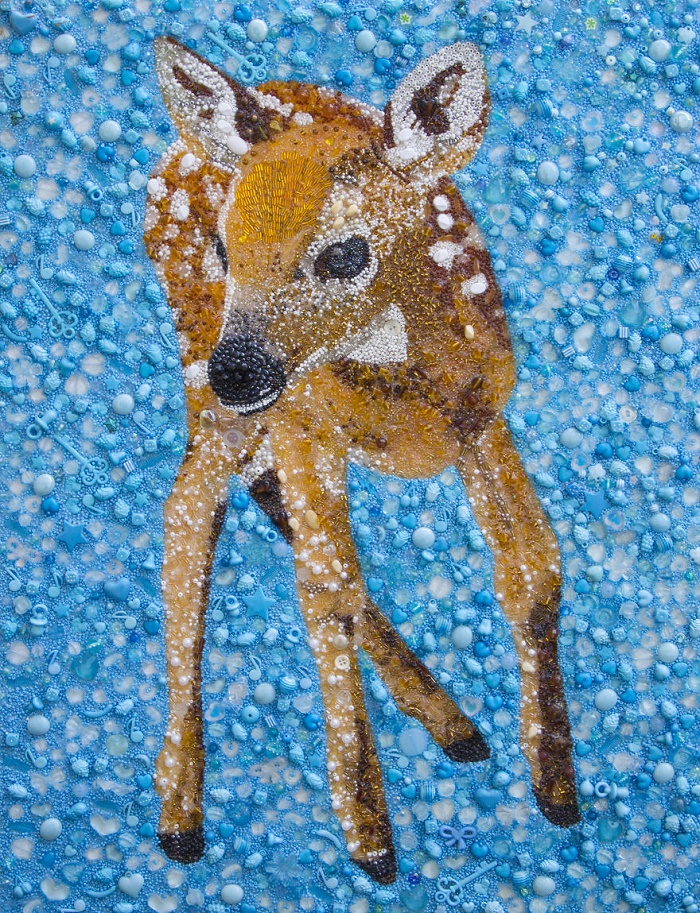 Deer made of buttons and beads. Artwork by Sarah Connor, British artist of applied art