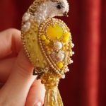 Sunny bird. Brooch made of Japanese beads, Swarovski crystals, natural pearls, gimp, mulina, velvet, sequins, satin and organza ribbons, on the underside - white leather
