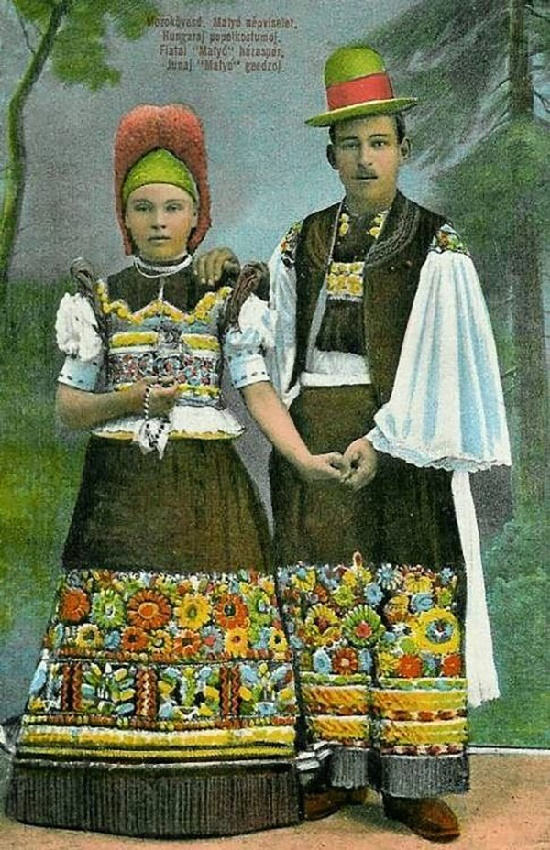 Hungarian folk art embroidery Matyo Roses. A couple in traditional embroidered costumes