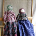 A couple of faceless folk dolls