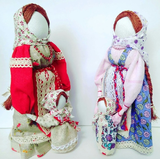 Two women and their daughters. Russian handmade applied art. Slavic faceless folk doll magical power