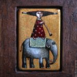 A girl on the elephant