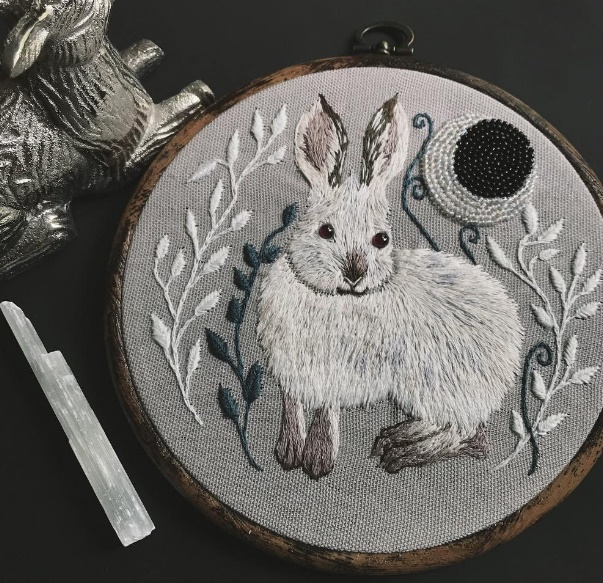 A white hare with garnet eyes