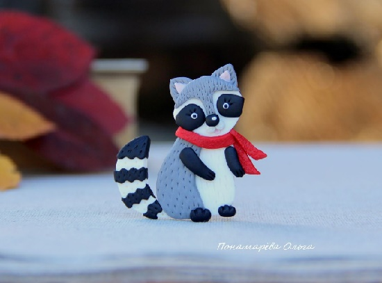 Charming Fenya the Raccoon. Brooch made of polymer clay