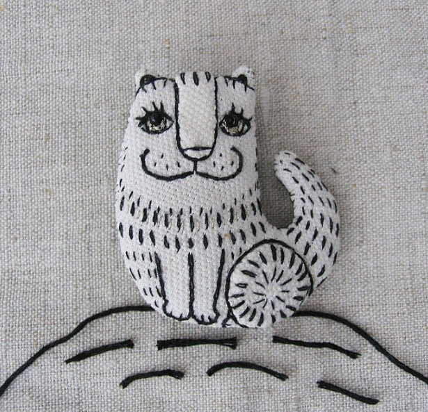'Cat Kolobrod'. Brooch made in a lubok style. Cotton, embroidery-black and metallized thread, pupils-beads. Bright atlas