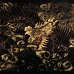 Phoenix Annam surrounded by swirling clouds. 19.1 x 25 x 6.2 cm varnish on wood