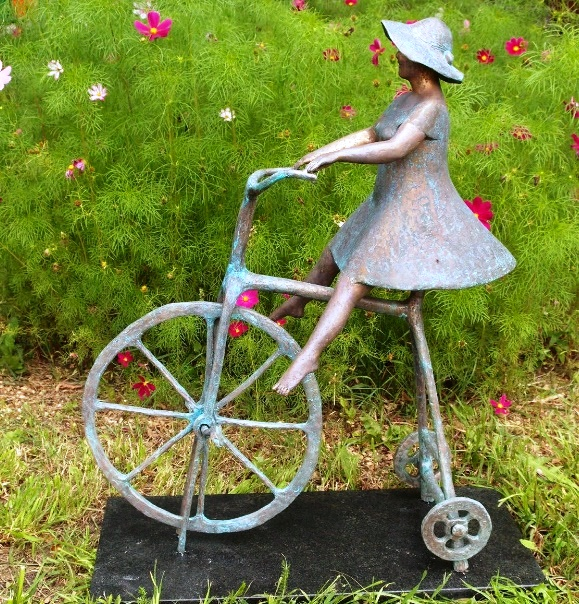Bronze sculpture of a bicyclist