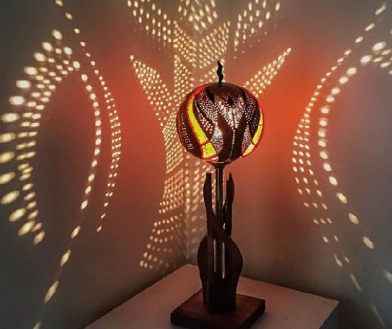Beautiful light fills the room with magical illumination. Gourd carving art by Jane Mawson