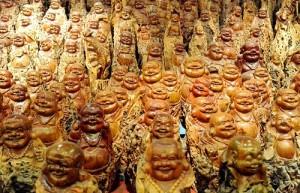 Shelves with Buddha sculptures