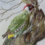 A bird in a tree. Stumpwork embroidery with 3-dimensional effect