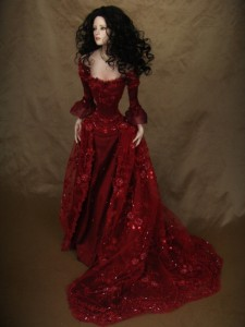 The dress edged with tiny rouched trim made of the same silk. The dress trails and trains. Mira