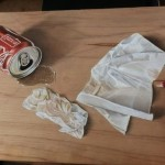 Coca-Cola and napkins. Spill. Pastel And Ink On Wood. Hyperrealistic drawing by Singaporean artist Ivan Hoo