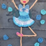 Dancing ballerina. Crochet street art installation created by British artist London Kaye