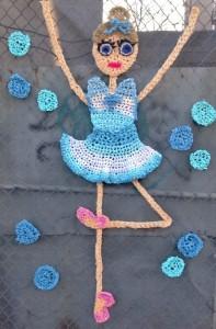 Dancing ballerina. Crochet street art installation created by British artist London Kaye