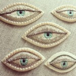 A set of Eye brooches