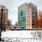Nizhny Novgorod, Russia. The many-storeyed house decorated with the beautiful mural 'Blossom'. Work by famous street artist Rustam Salemgarayev, aka Qbic